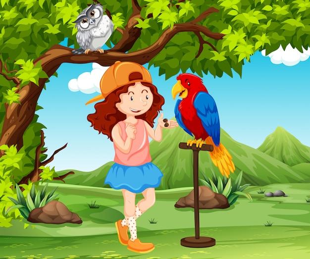 Een meisje die papegaai opleert