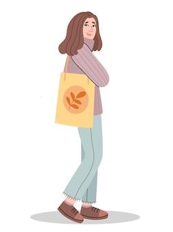 Een meisje houdt een ecotas vast.
