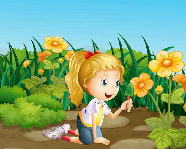Een meisje in de tuin met een schop