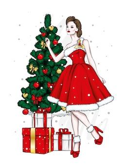 Een meisje in een mooie jurk en een kerstboom.