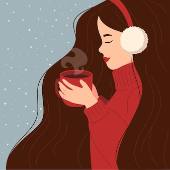 Een meisje in een warme trui drinkt cacao thee koffie warme chocolademelk nieuwjaar concept