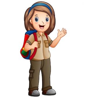 Een meisje in ontdekkingsreizigeruitrusting met rugzak