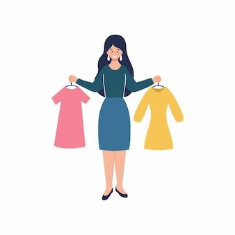 Een meisje kiest een jurk om te kopen. kleding kopen in de winkel. online shoppen vanuit je luie stoel.