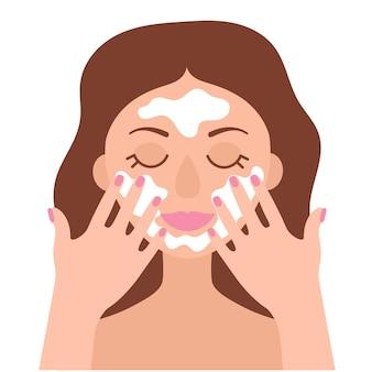 Een meisje met bruin haar wast haar gezicht met reinigingsschuim. platte afbeelding op witte achtergrond