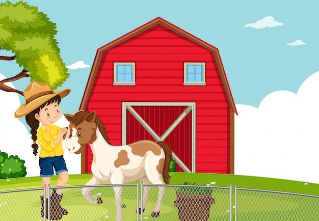 Een meisje met paard op landbouwgrond