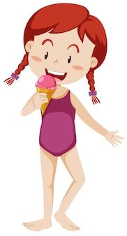 Een meisje met zwemmende reeks die roomijs eet