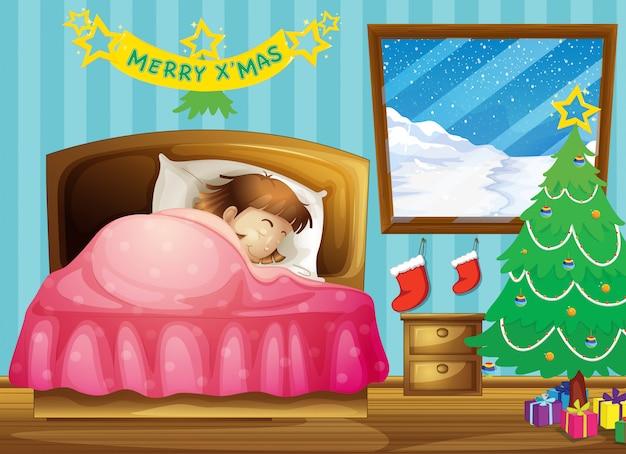 Een meisje slaapt in haar kamer met een kerstboom