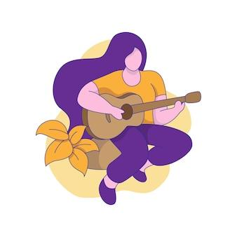 Een meisje speelt gitaar terwijl ze op een rots zit