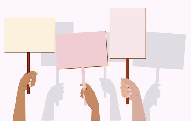 Een menigte protesterende mensen. demonstratie, protest. banier in de hand. silhouetten van de handen van demonstranten.