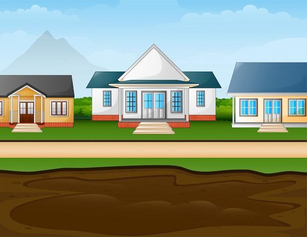 Een modderige plas vooraan de huizen in de voorsteden