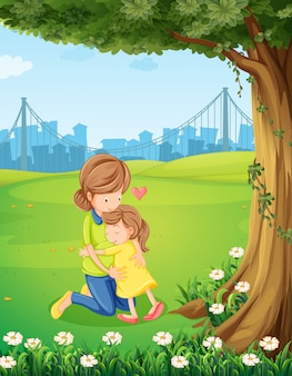 Een moeder die haar dochter onder de boom koestert