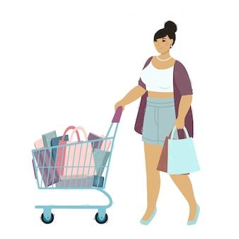 Een mooie jonge vrouw winkelt. gelukkig meisjeskarakter met een papieren zak en winkelwagentje.
