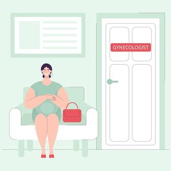 Een mooie jonge zwangere vrouw zit in het ziekenhuis op een stoel