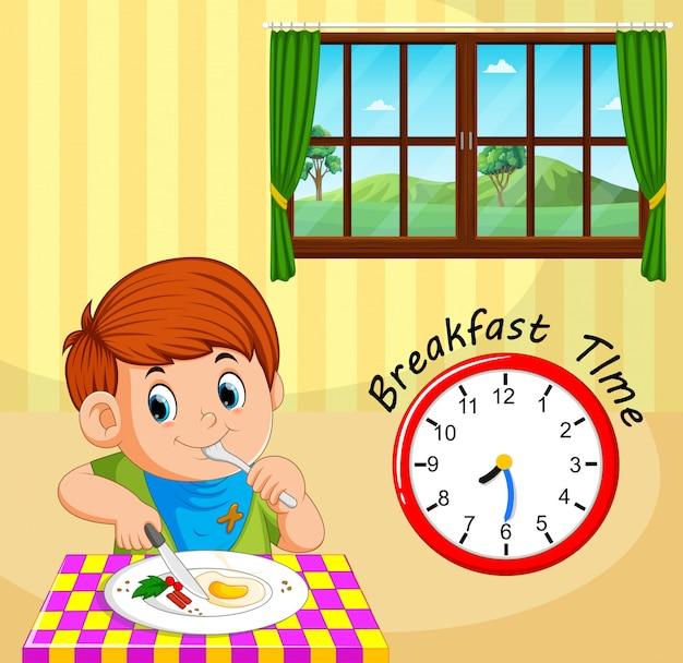 Een ontbijttijd voor de jongen