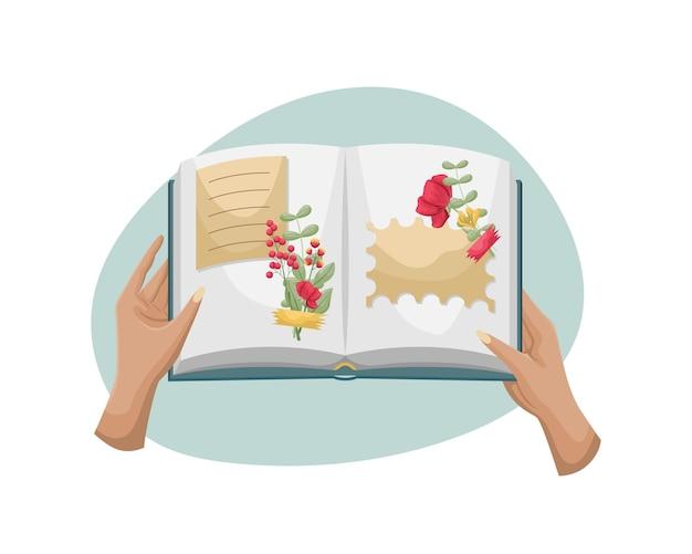 Een open boek met een herbarium. de handen van de vrouw houden een album met gedroogde bloemen vast.