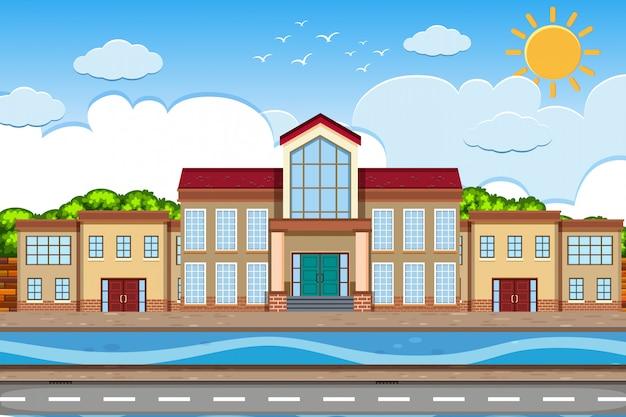 Een openluchtscène met schoolgebouw
