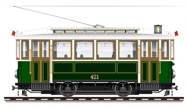 Een oude biaxiale tram van groene kleur. ecologisch stadsvervoer. zijaanzicht.