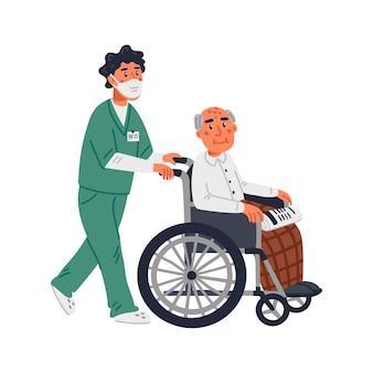Een oudere man in een rolstoel en een verpleger met een gezichtsmasker