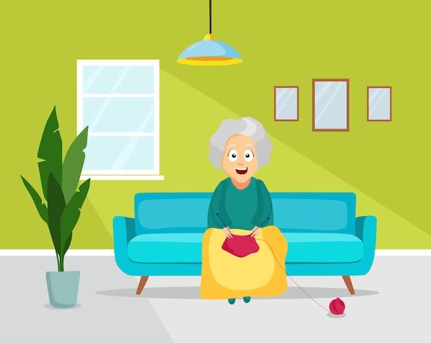 Een oudere vrouw zit op de bank in de woonkamer en breit. vector illustratie.