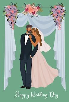 Een paar jonggehuwden op de achtergrond van een bruiloft tent en bloemen.