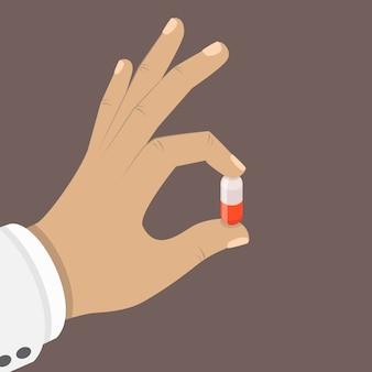 Een pil in een hand plat isometrisch concept.