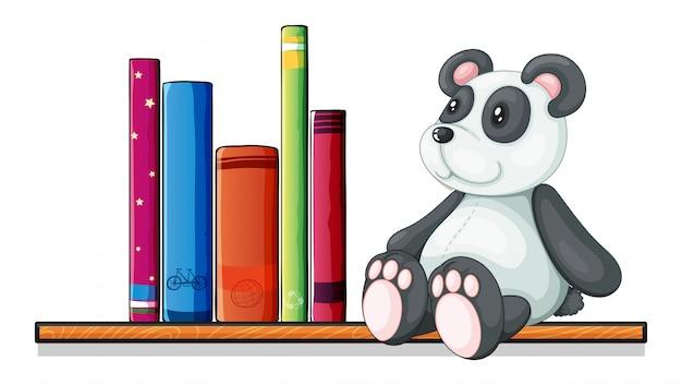 Een plank met boeken en een speelgoedpanda