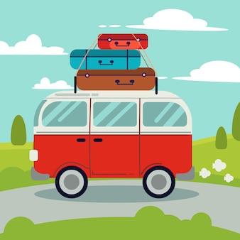Een rood busje op de weg. bovenop de rode bestelwagen zit veel tas voor een goede reis.