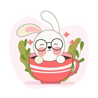 Een schattig klein wit konijn in een kopje