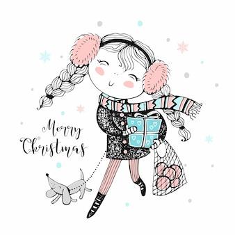 Een schattig meisje komt met cadeautjes en met een hond naar huis voor kerstmis.