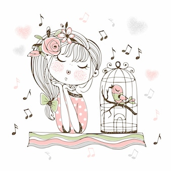 Een schattig meisje luistert naar haar vogel die in een kooi zingt.
