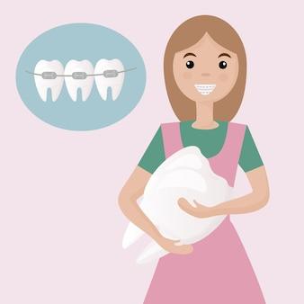 Een schattig meisje met een beugel op haar tanden
