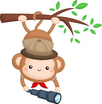 Een schattige aap die een safari ranger kostuum draagt terwijl hij aan een tak hangt