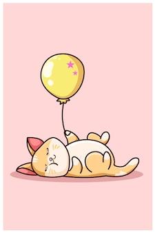 Een schattige kattenslaap met gele ballon