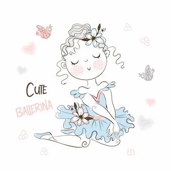 Een schattige kleine ballerina in een tutu poseert prachtig.