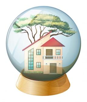 Een schattige kristallen bol met een groot huis erin