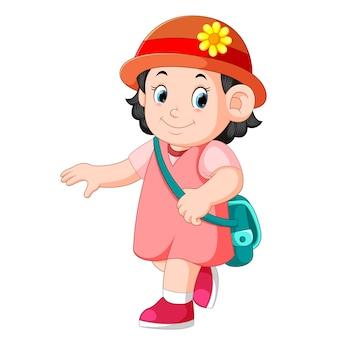 Een schoolmeisje dat loopt met een glimlach