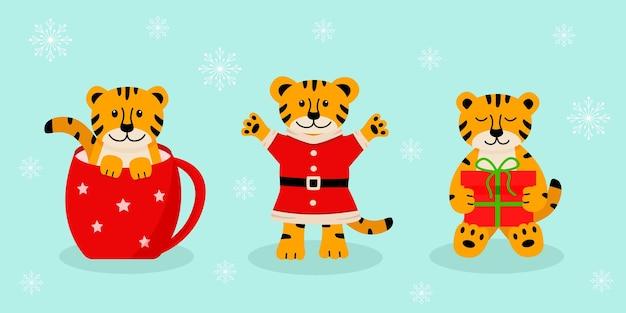Een set kersttijger, schattige cartoonsymbolen van het jaar. vectorillustratie, het concept van kerstmis en nieuwjaar.