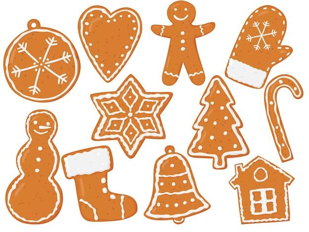 Een set peperkoekfiguren kerstkoekjes bruine peperkoek met wit patroon