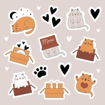 Een set stickers met schattige katten huisdieren dieren kat in een doos doodle stijl illustratie