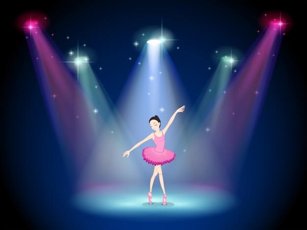 Een sierlijke ballerina in het midden van het podium