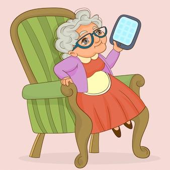 Een slimme oma die een tablet gebruikt