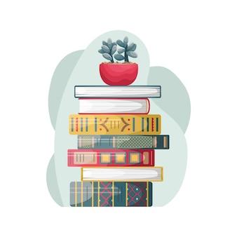 Een stapel boeken in retrostijl met een bloempot erop.