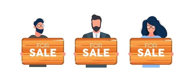 Een stel mensen met een houten bord te koop. jonge man in een pak met een houten bord geïsoleerd op een witte achtergrond. vector.
