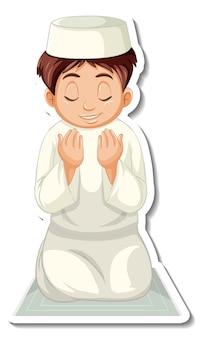 Een stickersjabloon met een moslimjongen die op een tapijt zit te bidden