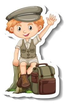Een stickersjabloon met een stripfiguur van een jongen in een safari-outfit Gratis Vector