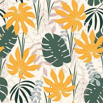 Een trending abstract naadloos patroon met tropische bladeren
