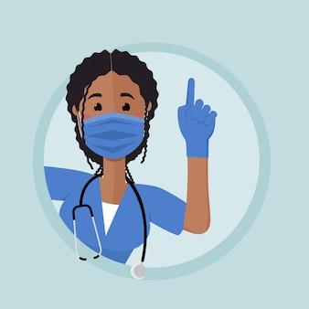 Een verpleegster met een afro-amerikaanse uitstraling kijkt om de hoek uit. ze steekt haar hand op en haar wijsvinger gaat omhoog. de vrouw draagt medische handschoenen en handschoenen.