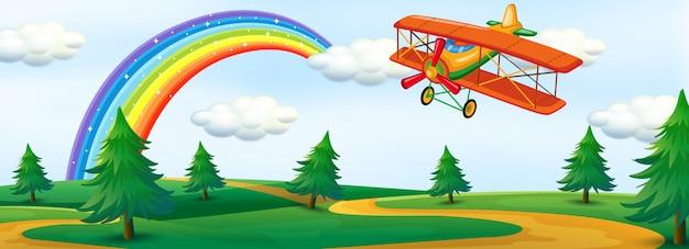 Een vliegtuig vliegt over de natuur