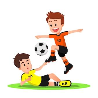 Een voetbaljongen die slide-tackles van zijn tegenstander ontwijkt