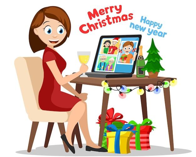 Een vrouw achter een computer communiceert met familieleden. online feest, kerst